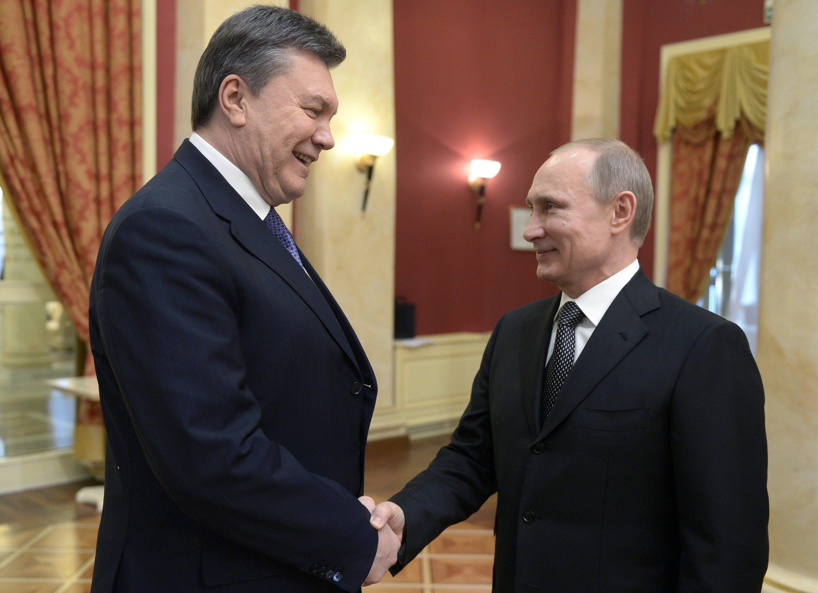 Президент РФ В.Путин и экс-президент Украины В.Янукович