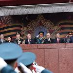 Правительственная трибуна. Президент Тибилов присутствует на мероприятиях в Москве