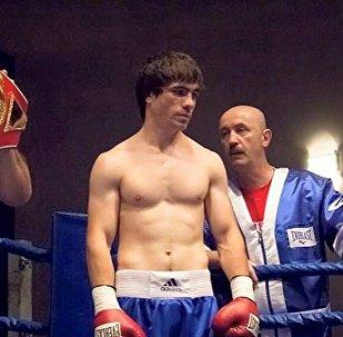 Осетинский боксер Сослан Тедеев и его тренер Виталий Сланов