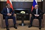 Встреча президентов России и Южной Осетии Владимира Путина и Анатолия Бибилова