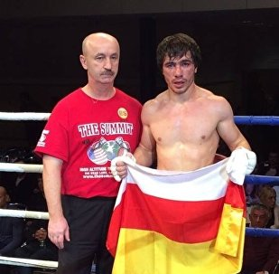 Сослан Тедеев с тренером Виталием Слановым