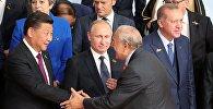 Президент РФ Владимир Путин на церемонии совместного фотографирования глав делегаций государств-участников Группы двадцати