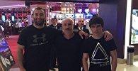 Боксеры Мурат Гассиев и Сослан Тедеев с тренером Виталием Слановым