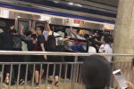 Beijing Crowds Push Train to Free Man Stuck in Platform Gap
