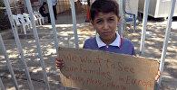 Сирийские беженцы возьми задел протеста во Афинах