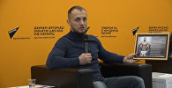 В пресс-центре Sputnik развернули флаг в поддержку Гассиева