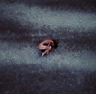 Снимок The Rebirth фотографа Andrea, занявший третье место в номинации Портрет (среди профессионалов)